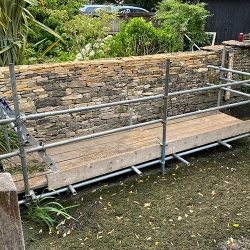 cotswold-stone-design-cheltenham-Retaining wall out of a river with scaffold
