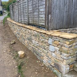 cotswold-stone-design-cheltenham-Retaining wall with mosaic top